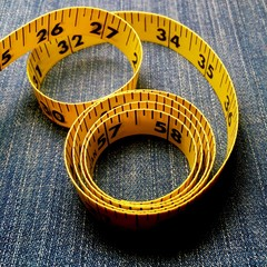 Tape measure on blue background