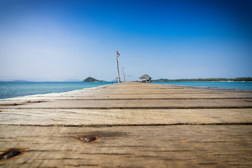wood bridge and seascape with blue sky - can use to display or montage on product