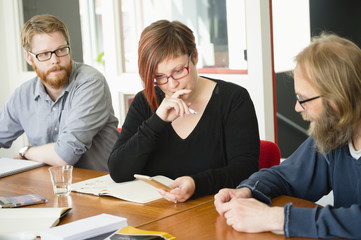 Sweden, People sharing ideas during work meeting