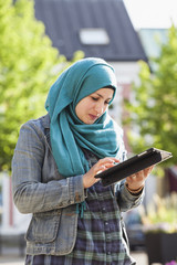 Sweden, Bleking, Solvesborg Muslim woman using tablet