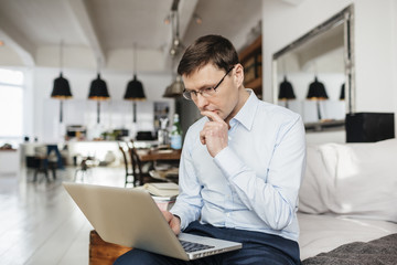 Germany, Man using computer with concentration