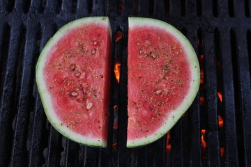 Grilled watermelon on a charcoal BBQ