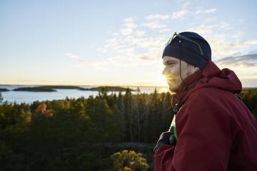Sweden, Stockholm Archipelago, Varmdo, Bjorno, Man looking at view