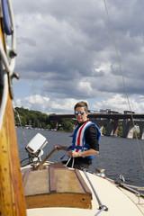 Sweden, Sodermanland, Stockholm, Malaren, Mature woman on deck of boat