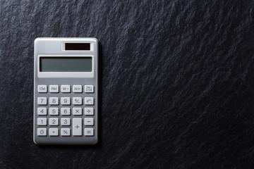 silver calculator on black background