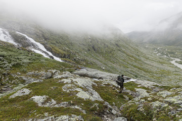 Norway, Tourist walking in Jotunheimen range