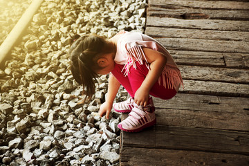 Children playing rock on the railroad