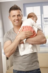 Handsome father holding baby girl