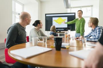 Sweden, People talking during work meeting