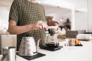 Portugal, Woman preparing coffee
