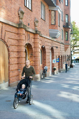 Sweden, Father pushing baby son (12-17 months) in stroller