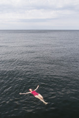 Sweden, Skane, Malmo, Woman floating on water