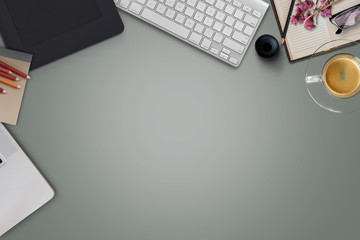 Workspace of Designer pastel top table with creative stuff .Top view with copy space, flat lay or hero header concept.