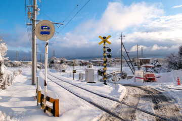 Railway track for local train with white snow fall in winter season,Japan