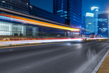 urban traffic road with cityscape at night in modern city of China.
