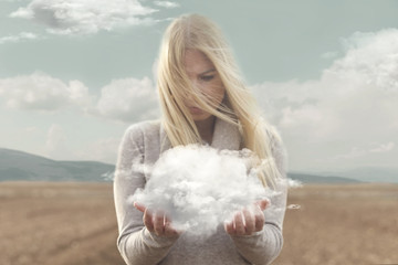 surreal moment , woman holding in her hands a soft cloud Wall mural