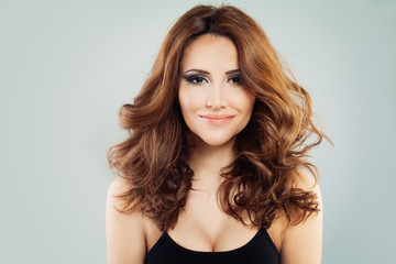 ith Curly Hair and Makeupl. Smiling Woman with Wavy Hairstyle