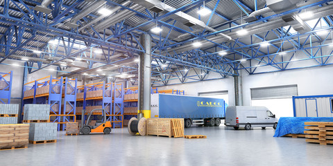 Concept of warehouse. The forklift in the big warehouse on blurred background.