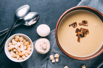Cream soup of mushrooms on a dark background