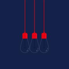 Three light bulbs on navy background