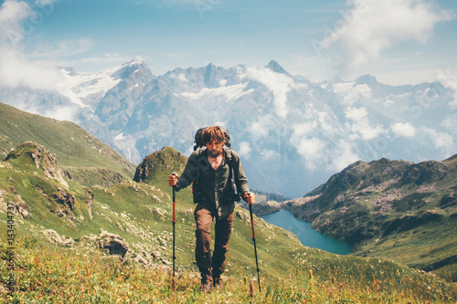9e527c75225e Traveler Man hiking with backpack Travel Lifestyle concept adventure summer  vacations outdoor mountaineering lake and mountains