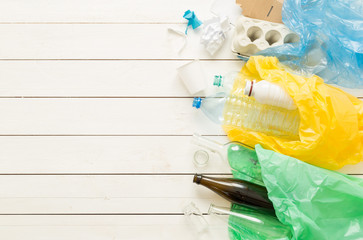 Recycling and ecology - sorting waste into bags