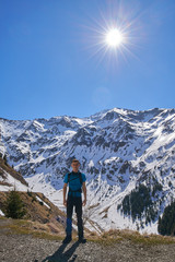 Teenager hiking into the mountains