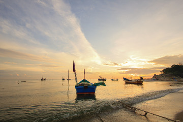 Group of small fishing boats at coast in morning ; Songkhla province, Thailand (selective focus)