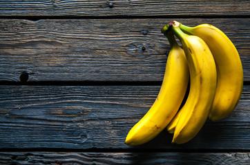 Fresh bananas on wooden background. Fruit, nature, food