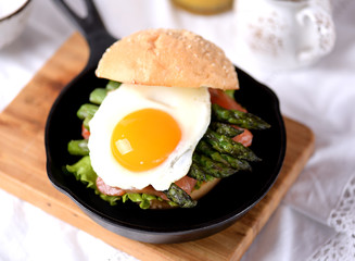 Healthy burger with salted salmon, asparagus and egg.