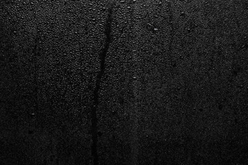 Part of series. Background photo of rain drops on dark glass, different size: small medium and large