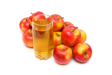 apple juice in glass and apples on a white background.