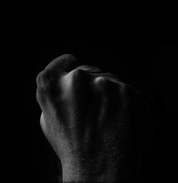 Male Fist On Black Background