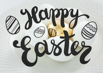 Grey easter graphic against white and gold eggs on plate