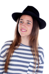 Pretty teenager girl with black hat posing at studio.