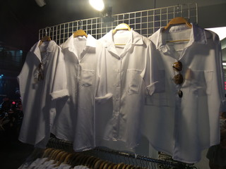 White shirt hang on the grille in night time
