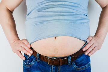 The belly of a fat man isolated on white background. Weight Loss.
