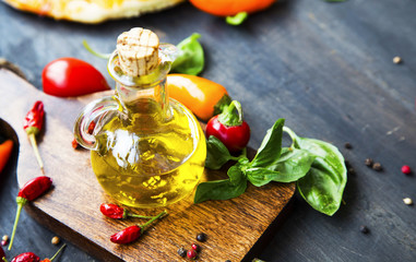 Olive oil glass bottle with spices and basil herb