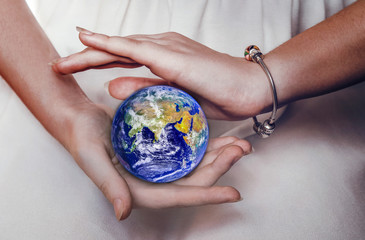 Beautiful planet Earth in female hands