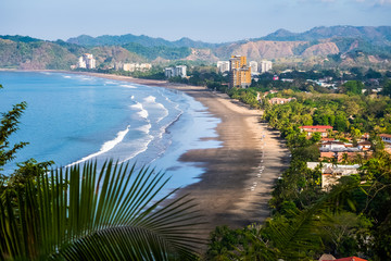 Fototapete - Tropical wide sandy beach of the town of Jaco, Costa Rica