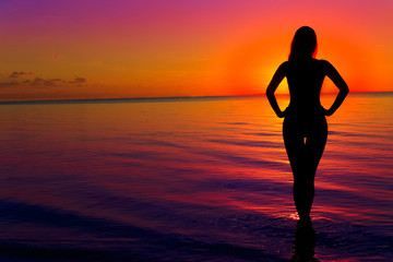 Woman silhouette on water