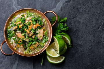 Seafood ceviche or mariscal in copper bowl - traditional Latin American dish with seafood, onion and lemon