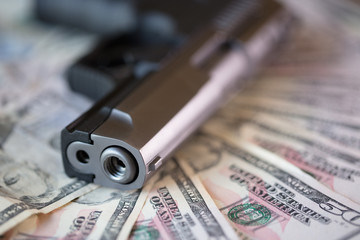 gun with money close up