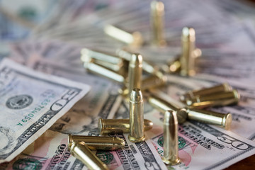 50 dollar bills with bullets detail