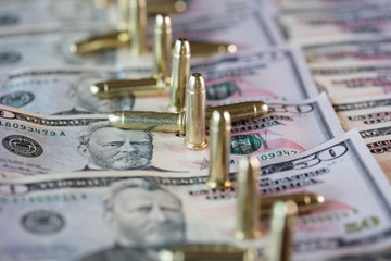 50 dollar bills with scattered bullets detail