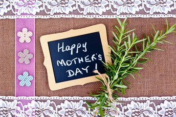 Happy Mother's Day - Rosemary and lace on burlap background