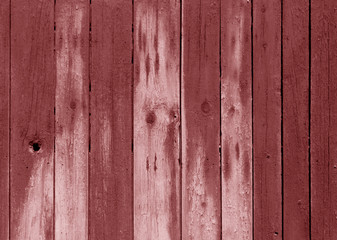 Wet red color wooden fence pattern.