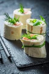 Tasty rolls with salmon, cheese and vegetables for a snack