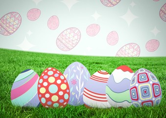 Easter eggs on grass with pattern