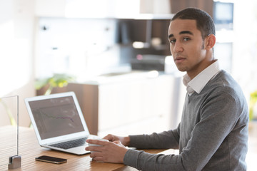 Man at desk with laptop in office